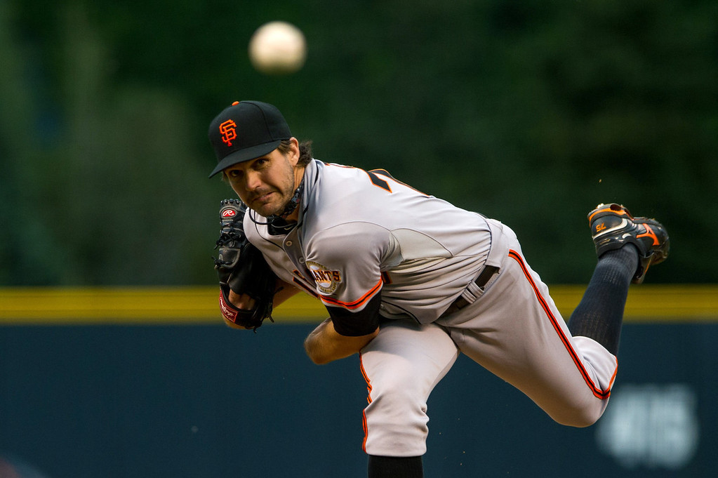 . Barry Zito #75 of the San Francisco Giants delivers a pitch against the Colorado Rockies in the first inning of a game against the Colorado Rockies at Coors Field on August 26, 2013 in Denver, Colorado. (Photo by Dustin Bradford/Getty Images)
