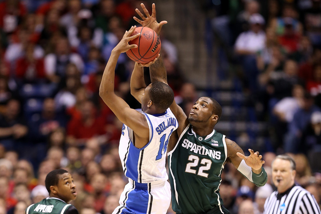 . Branden Dawson #22 of the Michigan State Spartans defends against a shot attempt by Rasheed Sulaimon #14 of the Duke Blue Devils in the first half during the Midwest Region Semifinal round of the 2013 NCAA Men\'s Basketball Tournament at Lucas Oil Stadium on March 29, 2013 in Indianapolis, Indiana.  (Photo by Andy Lyons/Getty Images)