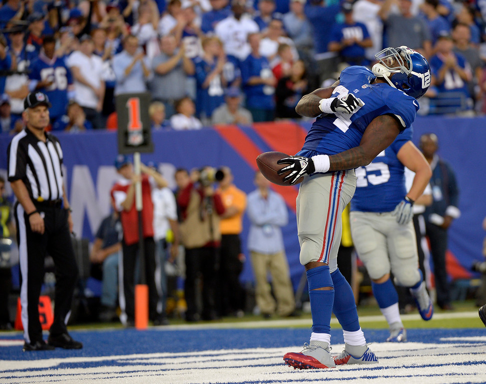 . EAST RUTHERFORD , NJ -SEPTEMBER 15: New York Giants running back Brandon Jacobs (34) screams out after scoring a touchdown during the third quarter September 15, 2013 MetLife Stadium. (Photo by John Leyba/The Denver Post)