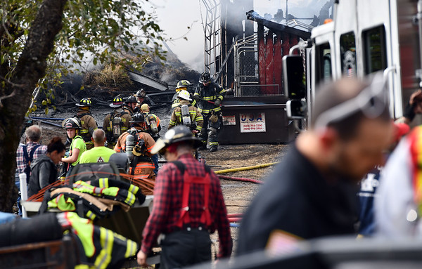 10/25/2019 Mike Orazzi | StaffrThe scene of a fire that destroyed a barn on Hill Road in Harwinton on Friday afternoon. Fire departments from multiple communities responded with mutual aid, at least one firefighter was taken from the scene by EMS.