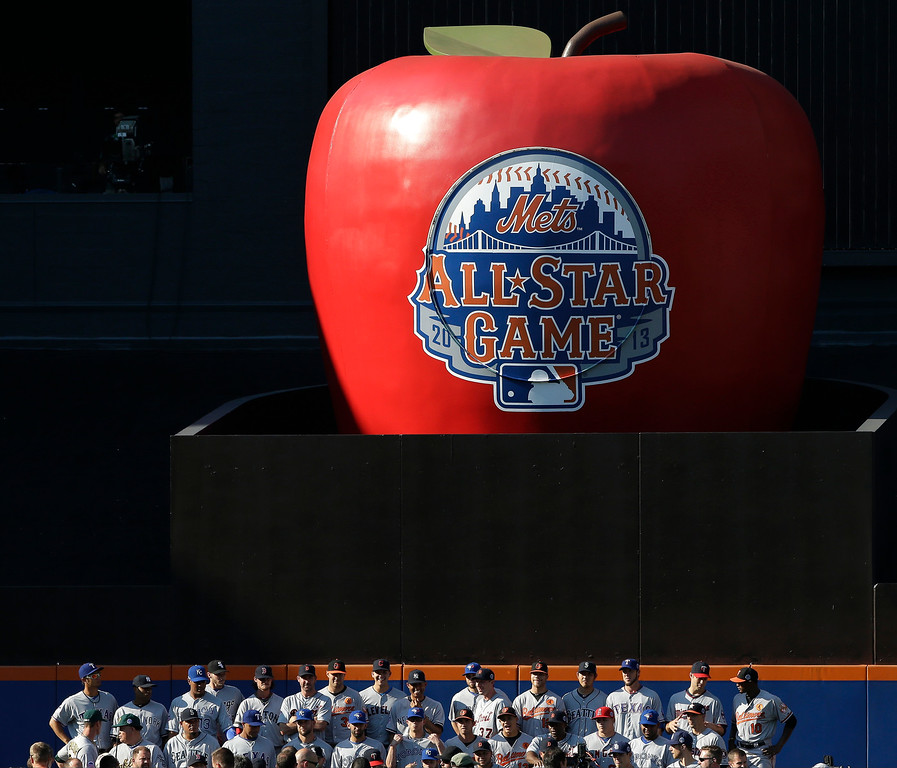 . Players on the American League team pose for a group photo beneath the home run apple at Citi Field before the MLB All-Star baseball game, on Tuesday, July 16, 2013, in New York. (AP Photo/Matt Slocum)