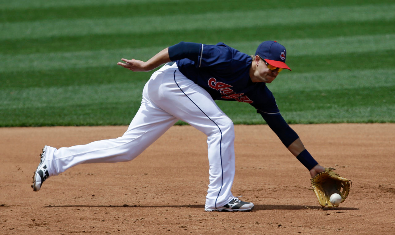 . Cleveland Indians\' Lonnie Chisenhall fields a ball hit by Minnesota Twins\' Josh Willingham in the third inning. Willingham was out at first base in a double play. (AP Photo/Tony Dejak)