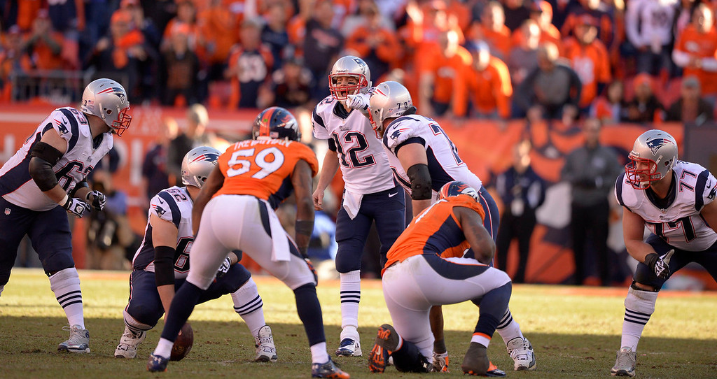 . New England Patriots quarterback Tom Brady (12) yells the call at his teammates during the third quarter. The Denver Broncos vs. The New England Patriots in an AFC Championship game  at Sports Authority Field at Mile High in Denver on January 19, 2014. (Photo by John Leyba/The Denver Post)