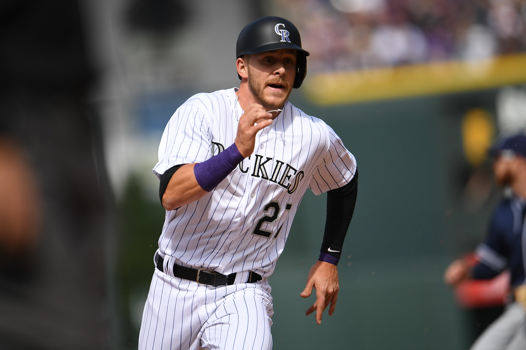 . Trevor Story (27) of the Colorado Rockies advances to third base on a double hit by Carlos Gonzalez (5). The Colorado Rockies played the San Diego Padres Friday, April 8, 2016 on opening day at Coors Field in Denver, Colorado. (Photo By RJ Sangosti/The Denver Post)