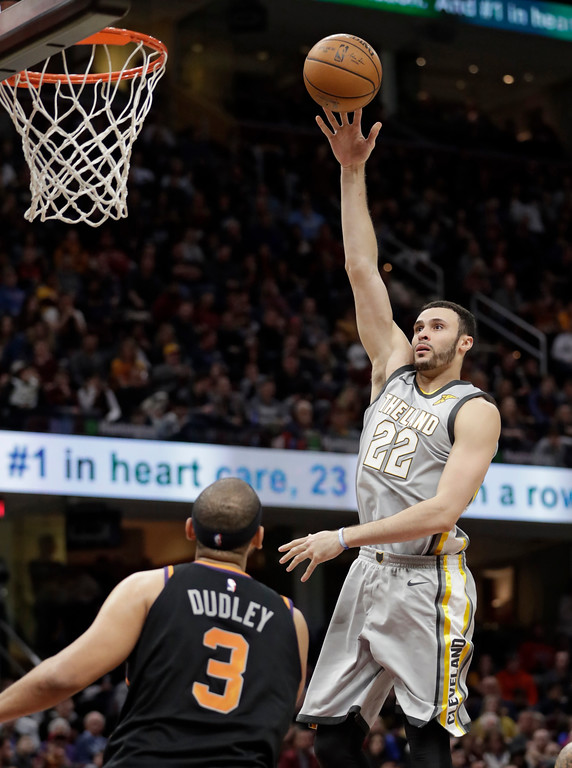. Cleveland Cavaliers\' Larry Nance Jr. (22) shoots over Phoenix Suns\' Jared Dudley (3) during the second half of an NBA basketball game Friday, March 23, 2018, in Cleveland. The Cavaliers won 120-95. (AP Photo/Tony Dejak)