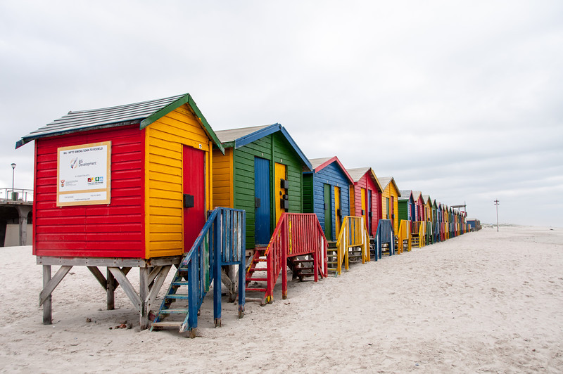 Row of colorful wooden houses near a beach in Cape Town