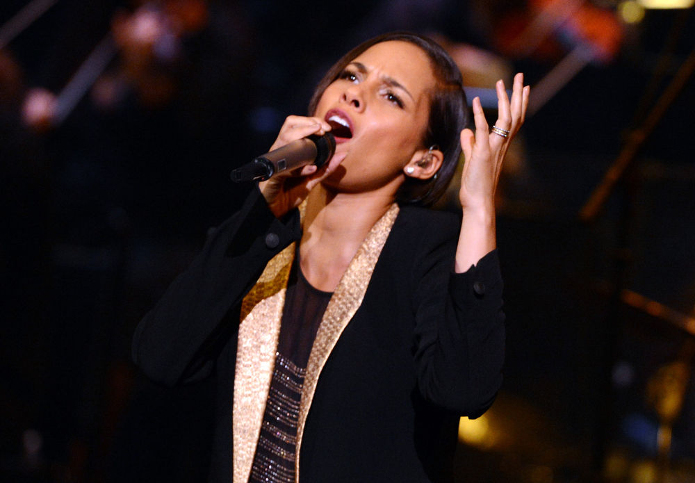 Description of . Singer Alicia Keys performs onstage during a celebration of Carole King and her music to benefit Paul Newman's The Painted Turtle Camp at the Dolby Theatre on December 4, 2012 in Hollywood, California.  (Photo by Michael Buckner/Getty Images for The Painted Turtle Camp)