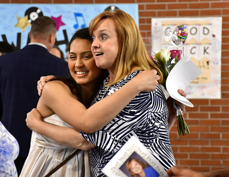 6/11/2019 Mike Orazzi | Staff Sarah Jusa hugs Maureen Brummett during Brummett's farewell reception at Plainville High School on Tuesday.