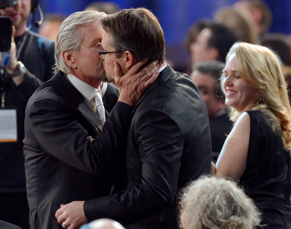 . Michael Douglas gives Matt Damon a kiss after Douglas won Outstanding Performance by a Male Actor in a Television Movie or Miniseries for his performance in �Behind the Candelabra� during the show of the 20th Annual Screen Actors Guild Awards  at the Shrine Auditorium in Los Angeles, California on Saturday January 18, 2014 (Photo by Andy Holzman / Los Angeles Daily News)