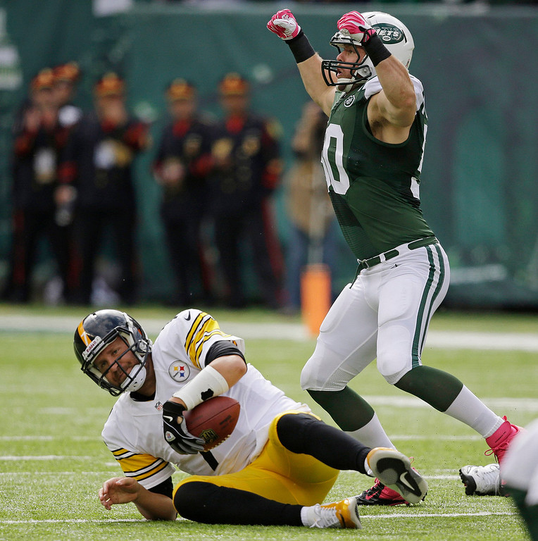 . New York Jets outside linebacker Garrett McIntyre (50) reacts after sacking Pittsburgh Steelers quarterback Ben Roethlisberger (7) during the first half of an NFL football game Sunday, Oct. 13, 2013, in East Rutherford, N.J.  (AP Photo/Seth Wenig)