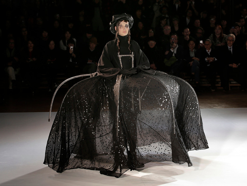 . A model wears a creation for Japanese designer Yohji Yamamoto\'s fall-winter 2015-2016 ready to wear fashion collection, presented in Paris, France, Friday, March 6, 2015. (AP Photo/Christophe Ena)