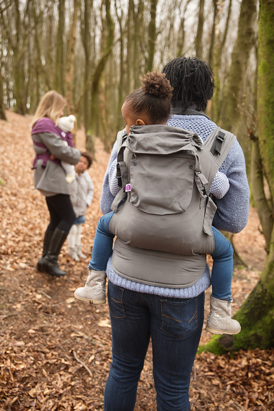 Izmi_Accessories_Lifestyle_Pocket_And_Hood_Mid_Grey_On_Mid_Grey_Toddler_Carrier_Back_Carry.jpg