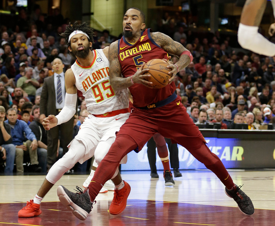 . Cleveland Cavaliers\' JR Smith (5) drives against Atlanta Hawks\' DeAndre\' Bembry (95) in the second half of an NBA basketball game, Tuesday, Dec. 12, 2017, in Cleveland. (AP Photo/Tony Dejak)