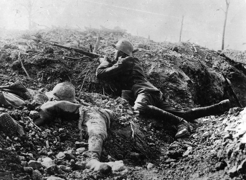 . A German rifleman beside the corpse of a French soldier in a trench at Fort Vaux, France.   (Photo by Hulton Archive/Getty Images)