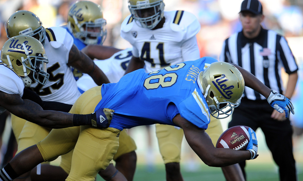 . UCLA running back Malcolm Jones (28) during the football spring showcase college football game in the Rose Bowl on Saturday, April 27, 2013 in Pasadena, Calif.    (Keith Birmingham Pasadena Star-News)