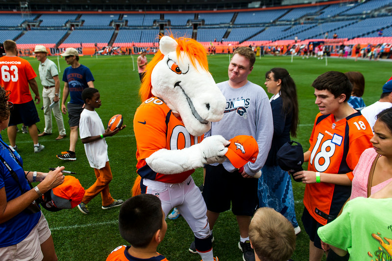 . Miles Mascot of the Denver Broncos signs autographs during the National Sports Center for the Disabled\'s Denver Broncos Ability Clinic at Sports Authority Field at Mile High on Tuesday, July 08, 2014 in Denver, CO. (Photo by Kent Nishimura/The Denver Post)