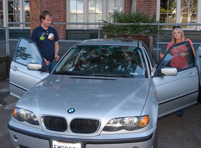 Kristin tries out Cory's BMW.