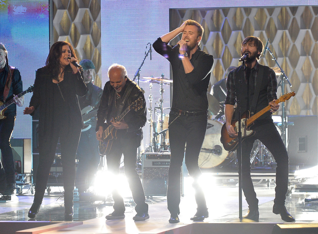 . (L-R) Hillary Scott, Charles Kelley and Dave Haywood of Lady Antebellum and Peter Frampton (C) perform on CMT Artists Of The Year 2013 at Music City Center on December 3, 2013 in Nashville, Tennessee.  (Photo by Rick Diamond/Getty Images for CMT)