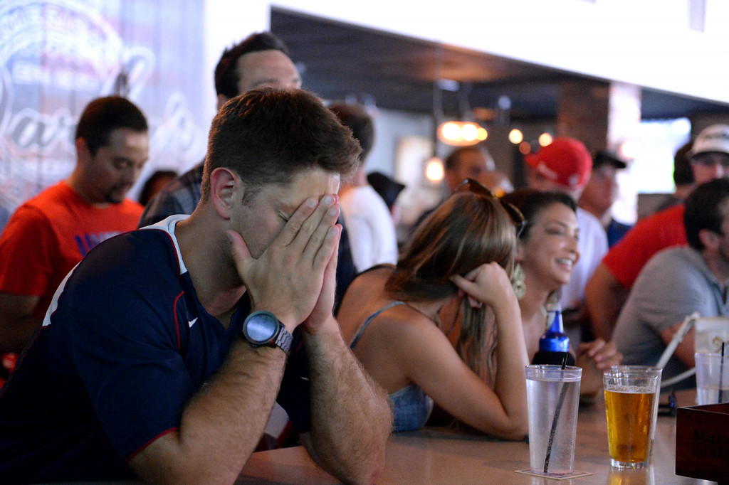 . Kyle Pattison, 31, of Lake Arrowhead, reacts after the US men\'s soccer team lost 2-1 to Belgium on Tuesday, July 1, 2014 at Darby\'s American Cantina in Redlands, Ca. (Photo by Micah Escamilla/The Sun)