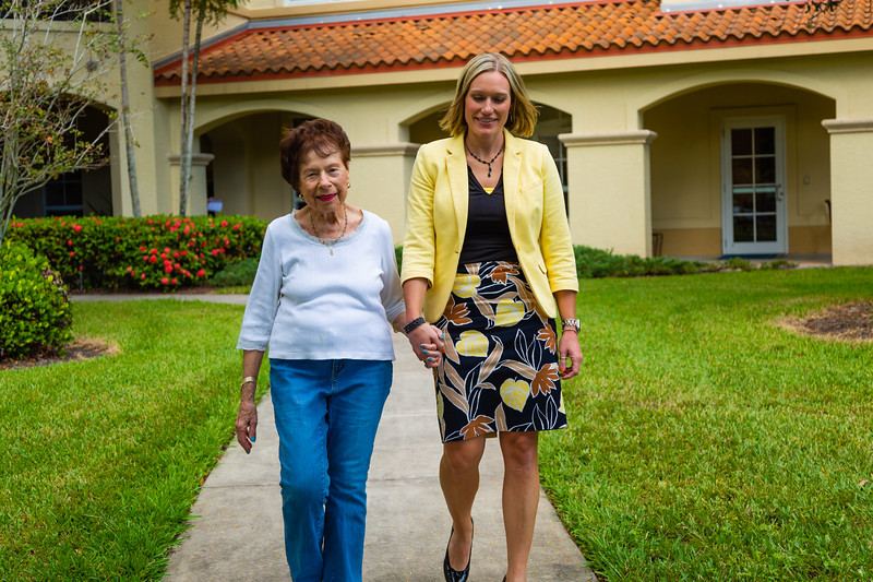 Libby Klein (left), 88, walks with Stephanie Frazier, Senior Vice President of Housing, along a path at Tradition at MorseLife on Wednesday, October 31, 2018.[JOSEPH FORZANO/palmbeachpost.com]