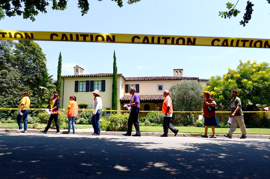 . Occupy and ACCE protesters descend on the home of Timothy Sloan, chief financial officer of Wells Fargo, in San Marino to protest foreclosures Saturday, July 27, 2013. (SGVN/Staff Photo by Sarah Reingewirtz)