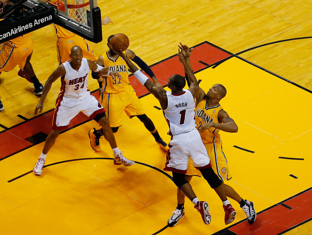 . MIAMI, FL - MAY 30:  Chris Bosh #1 of the Miami Heat goes to the basket against the Indiana Pacers during Game Six of the Eastern Conference Finals of the 2014 NBA Playoffs at American Airlines Arena on May 30, 2014 in Miami, Florida.  (Photo by Chris Trotman/Getty Images)