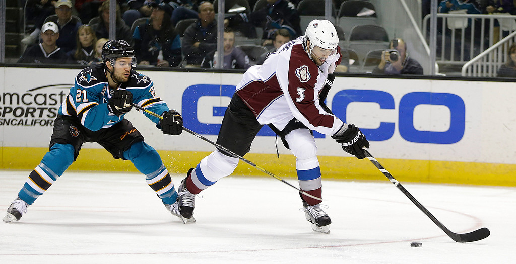 . Colorado Avalanche\'s Ryan O\'Byrne, right, moves the puck past San Jose Sharks\' T.J. Galiardi (21) during the second period of an NHL hockey game Tuesday, Feb. 26, 2013, in San Jose, Calif. (AP Photo/Ben Margot)