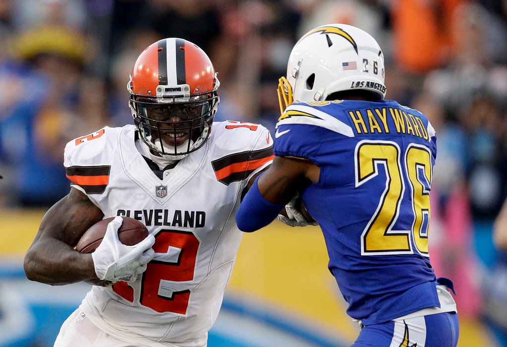 . Cleveland Browns wide receiver Josh Gordon runs against Los Angeles Chargers cornerback Casey Hayward during the second half of an NFL football game Sunday, Dec. 3, 2017, in Carson, Calif. (AP Photo/Jae C. Hong)