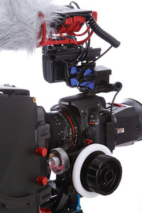 Canon EOS Rebel SL1/100D on a Fotga DP500 DSLR Rail 15mm rod support system with a Kamerar Matte Box Max-1 and a Kamerar FF-3 Follow Focus with 15mm quick release rod clamps. This rail system rig is supported on a Manfrotto MVH500AH fluid video head on Benro 3580 tripod legs. For audio capture, I used a Rode VideoMic with Rycote Suspension system and a Rode Dead Cat Wind Muff. I also connected a Sennheiser EW 100 G2 wireless transmitter on top of a Beachtek MCC-2 Audio Adapter and Bracket . To aid in critical focus, I used a Zacuto Z-Finder Pro 2.5x with the new Zacuto Gorilla Plate version 2 with the Zacuto GH3 frame. The Canon EOS Rebel SL1/100D is paired with the Rokinon 35mm T1.5 Cine Lens.