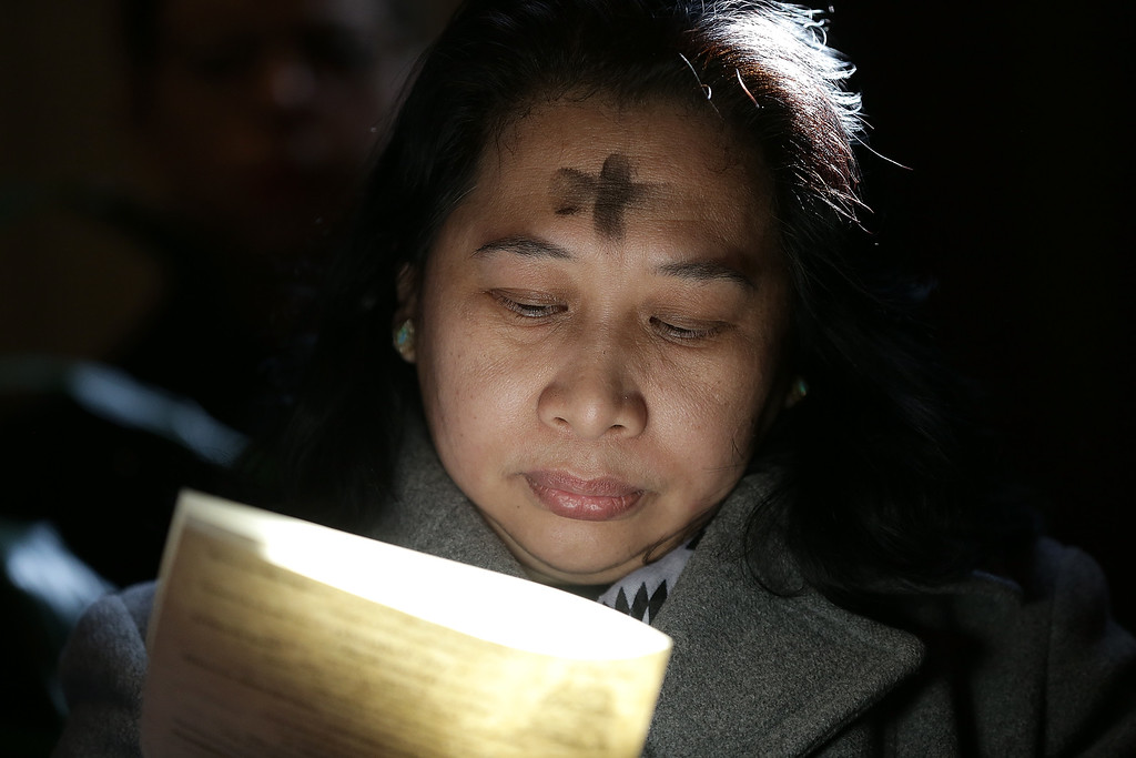 . Gilda Baric attends Ash Wednesday Mass at the Cathedral of St. Matthew the Apostle February 18, 2015 in Washington, DC. On Ash Wednesday, Catholics around the globe observe the beginning of Lent and observe the date with fasting and receiving ashes on their foreheads in the Sign of the Cross as a symbol of penance and conversion.  (Photo by Win McNamee/Getty Images)