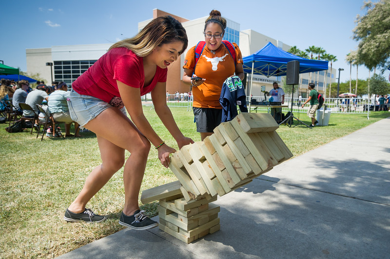Students Noreen Franco and Dyeanna Hernandez pass time by play giant jenga on the east lawn at the Islander Cultural Alliance event