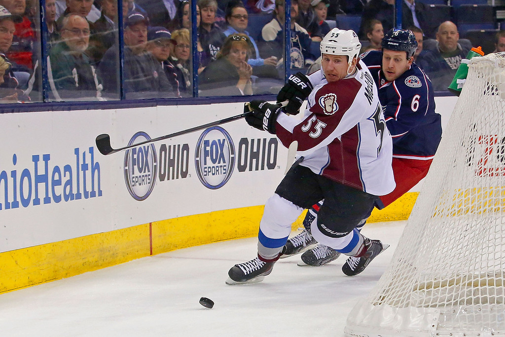 . COLUMBUS, OH - APRIL 1:  Cody McLeod #55 of the Colorado Avalanche and Nikita Nikitin #6 of the Columbus Blue Jackets skate after the puck during the first period on April 1, 2014 at Nationwide Arena in Columbus, Ohio. (Photo by Kirk Irwin/Getty Images)