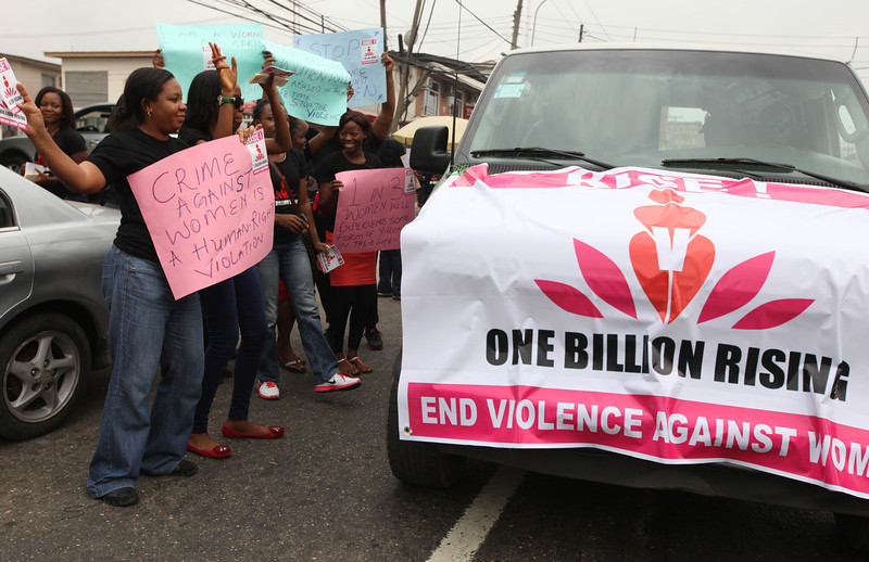 ". Nigeria women dances on a street to support the ""One Billion Rising\"" global campaign in Lagos, Nigeria, Thursday, Feb. 14, 2013. Thousands of women and children in various cities in the country danced in the streets, in malls and other places to express support for the One Billion Rising movement, a worldwide call to end violence against women and girls. (AP Photo/Sunday Alamba)"