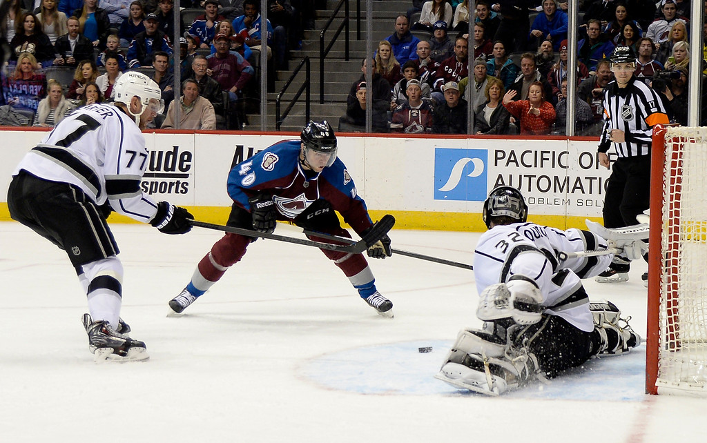 . DENVER, CO - FEBRUARY 18: Los Angeles Kings goalie Jonathan Quick (32) makes on of his 43 save on a shot as Colorado Avalanche left wing Alex Tanguay (40) tries to get to the rebound with Los Angeles Kings center Jeff Carter (77)  during the third period February 18, 2015 at Pepsi Center. (Photo By John Leyba/The Denver Post)