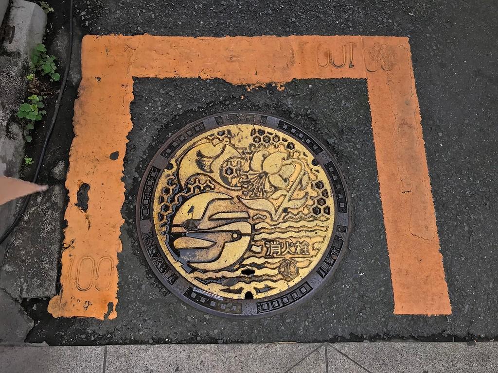 A yellow manhole.
