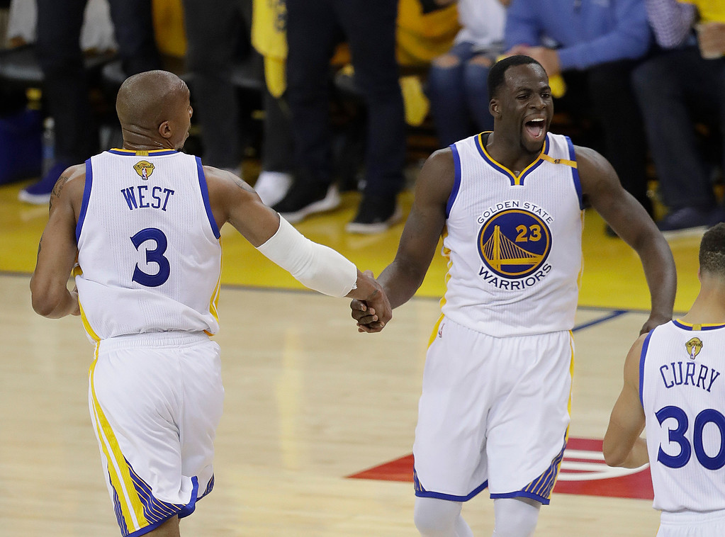 . Golden State Warriors forward David West (3) celebrates with forward Draymond Green (23) during the first half of Game 5 of basketball\'s NBA Finals against the Cleveland Cavaliers in Oakland, Calif., Monday, June 12, 2017. (AP Photo/Marcio Jose Sanchez)