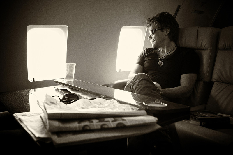 . June 17, 2011 - Jon Bon Jovi looks out of the window during his band Bon Jovi\'s private plane flight from Bucharest, Romania to Cologne, Germany during the European leg of their concert tour on June 11, 2011.  (Photo credit: David Bergman / Bon Jovi)