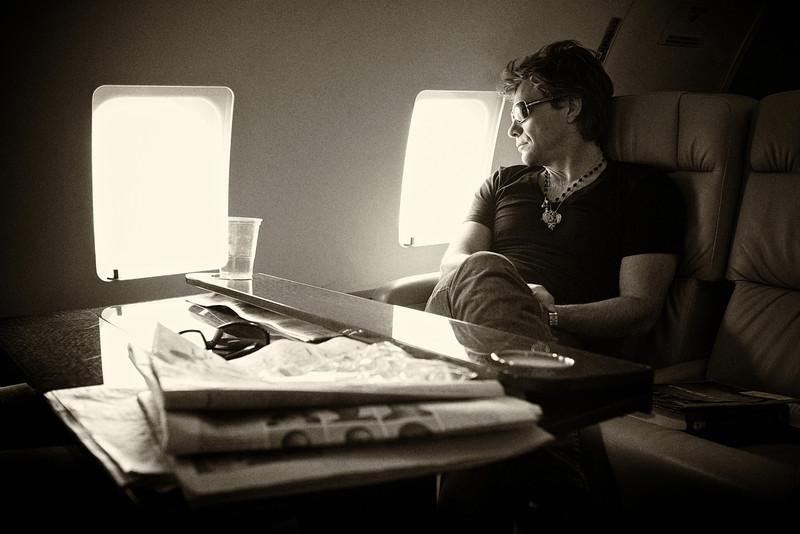 . June 17, 2011 - Jon Bon Jovi looks out of the window during his band Bon Jovi\'s private plane flight from Bucharest, Romania to Cologne, Germany during the European leg of their concert tour on June 11, 2011.  (Photo credit: David Bergman / Bon Jovi)
