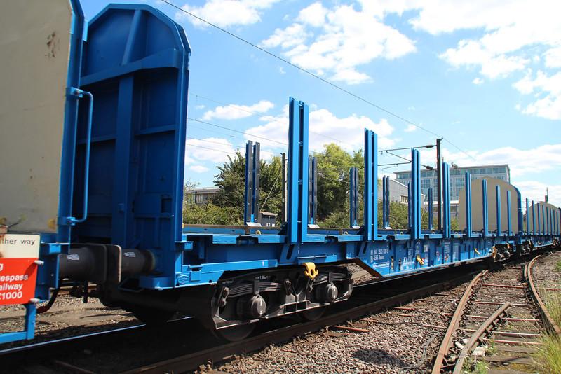 New Colas Log Wagon IWA 83.84.3523036-5 on 6z47 Dollands Moor-Gloucester passing Mitre Bridge Jct 31/08/12.