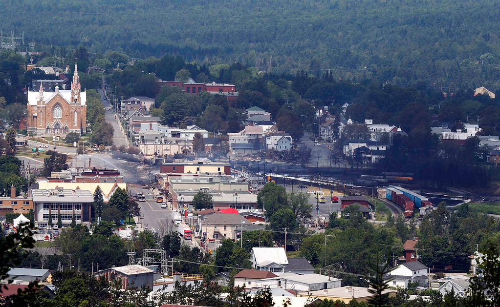 . A view of the town from a lookout point at Lac Megantic, Quebec, July 7, 2013.  A driverless freight train carrying tankers of petroleum products derailed at high speed and exploded into a giant fireball in the middle of the small Canadian town of Lac-Megantic early on Saturday, destroying dozens of buildings and leaving an unknown number of people feared missing.  REUTERS/Christinne Muschi