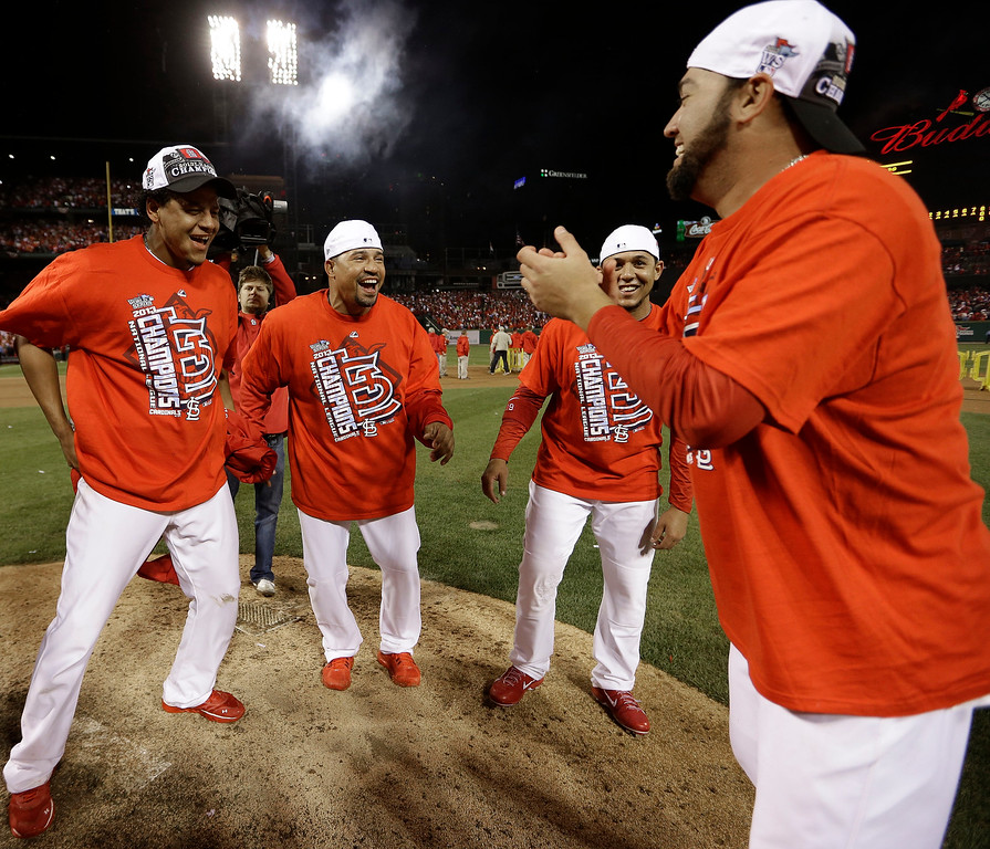 . The St. Louis Cardinals celebrate after Game 6 of the National League baseball championship series against the Los Angeles Dodgers, Friday, Oct. 18, 2013, in St. Louis. The Cardinals won 9-0 to win the series. (AP Photo/David J. Phillip)