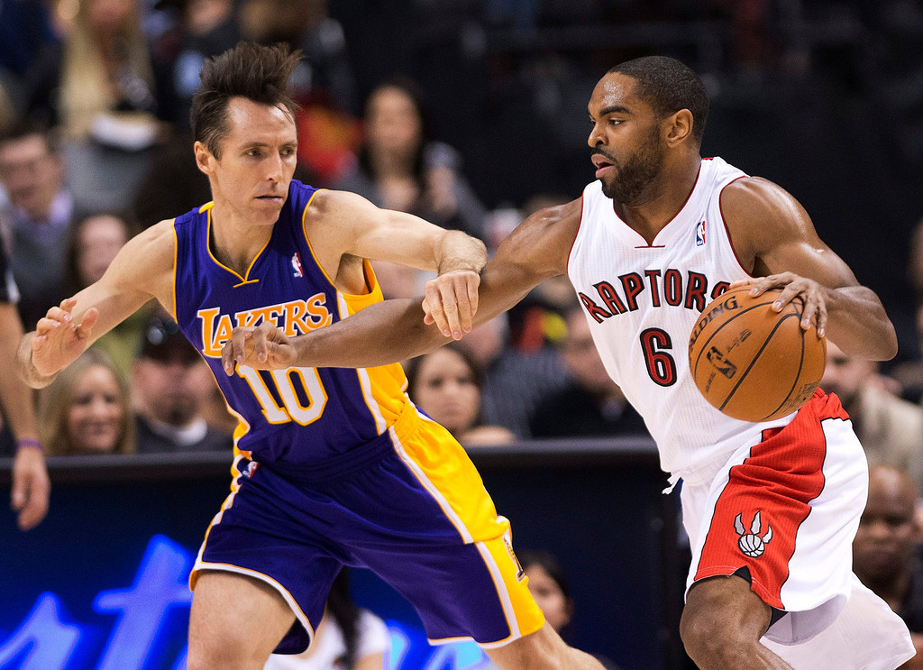 . Los Angeles Lakers guard Steve Nash, left, applies pressure on Toronto Raptors forward Alan Anderson, right, during first half NBA basketball action in Toronto on Sunday Jan. 20, 2013. (AP Photo/THE CANADIAN PRESS,Nathan Denette)
