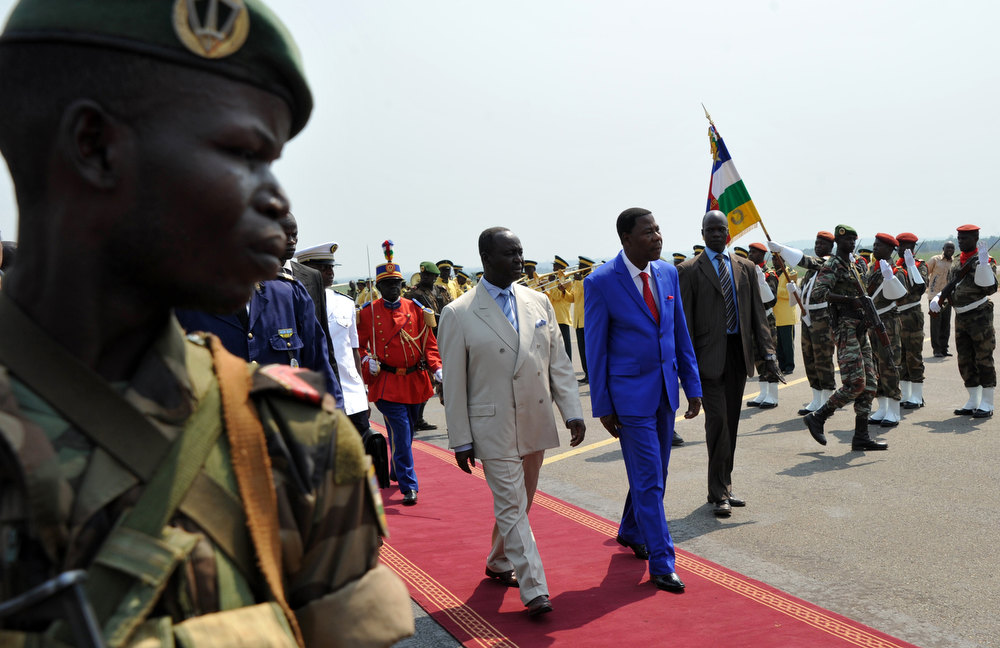 Description of . The President of the Central African Republic, Francois Bozize (Center L), walks alongside the current president of the African Union and President of Benin Yayi Boni (Center R), after the latter arrived at the airport in Bangui on December 30, 2012, for talks over the current crisis. Rebels in the Central African Republic who have advanced towards the capital Bangui warned they could enter the city even as the head of the African Union prepared to launch peace negotiations. Central African President Francois Bozize also stated today he was open to a national unity government after talks with rebel leaders and that he would not run for president in 2016. SIA KAMBOU/AFP/Getty Images