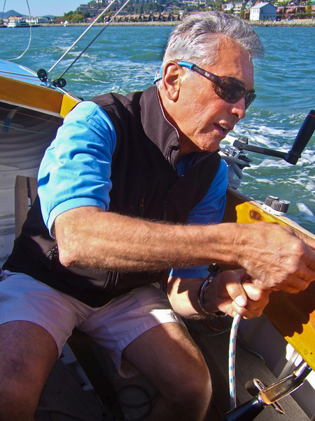 "Ron Young hauling in line - Sailing on San Francisco Bay on Ron Young's classic wooden boat ""Youngster"""