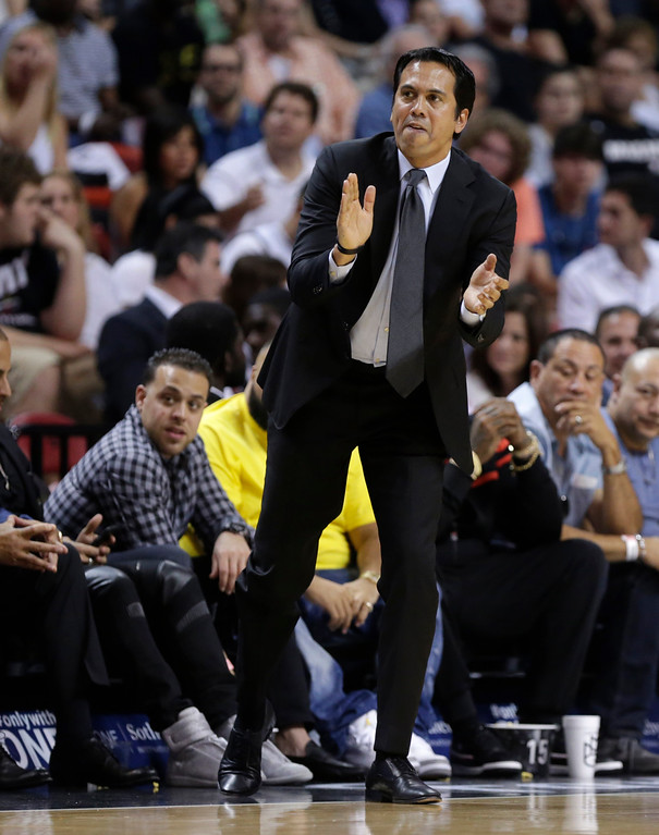 . Miami Heat head coach Erik Spoelstra watches the action during the first half of an NBA basketball game against the Cleveland Cavaliers, Saturday, March 19, 2016, in Miami. (AP Photo/Lynne Sladky)