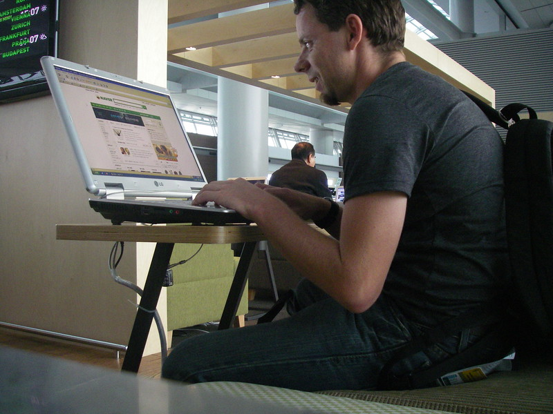 Updating my Facebook status on the free wifi laptops they have in the waiting area of the airport.  How awesome is that?