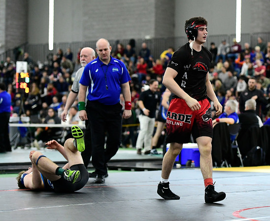 2/22/2019 Mike Orazzi | Staff Bristol Eastern's Justin Marshall and Fairfield Warde's Noah Zuckerman in a 152 pound match during the CIAC State Open Wrestling Tournament at the Floyd Little Athletic Center in New Haven Saturday.