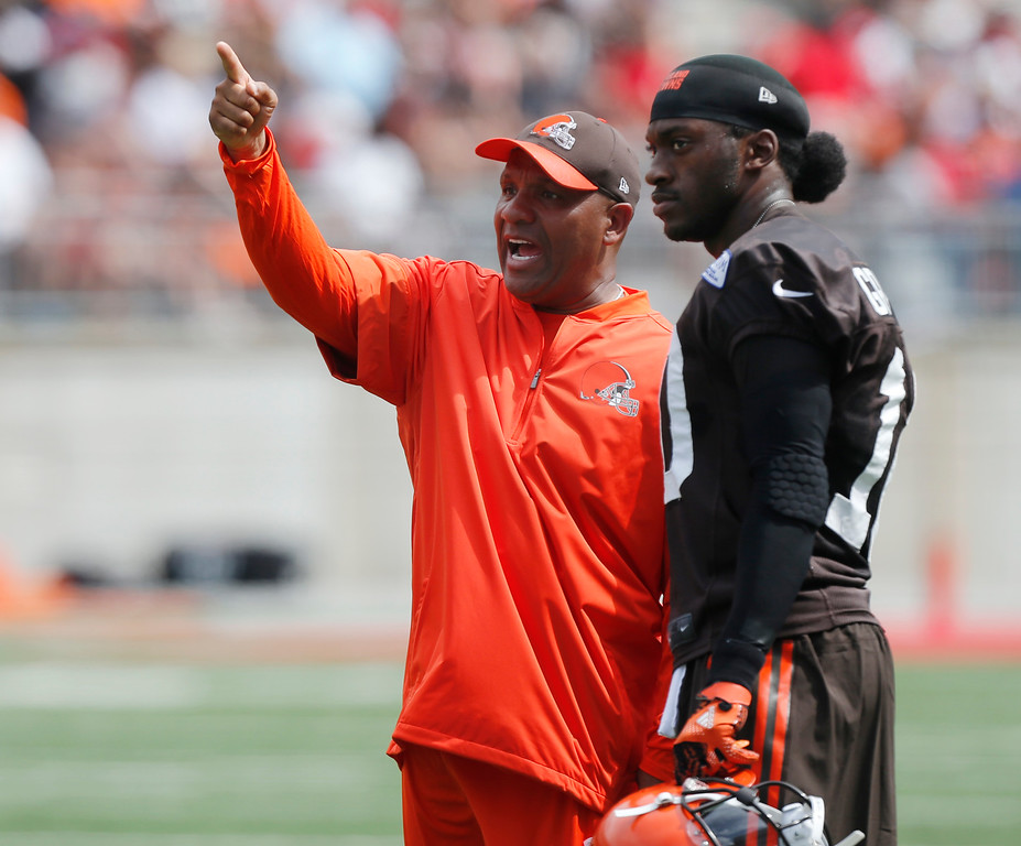 . Cleveland Browns head coach Hue Jackson, left, talks with quarterback Robert Griffin III during their orange and brown scrimmage at the NFL football team\'s training camp Saturday, Aug. 6, 2016, in Columbus, Ohio. (AP Photo/Jay LaPrete)