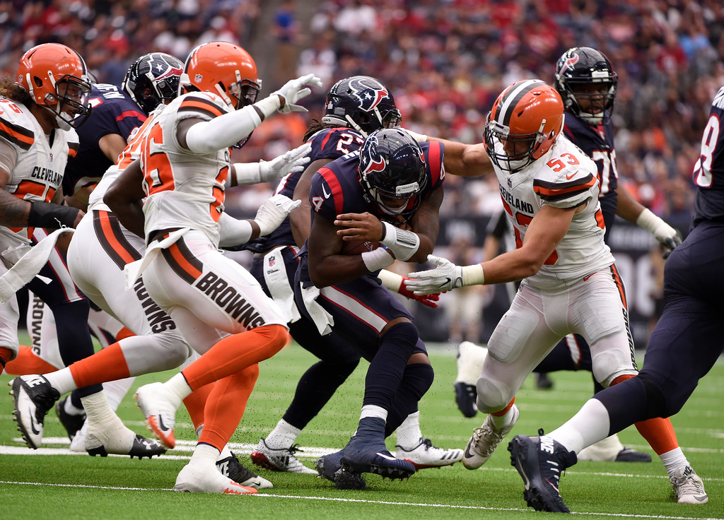 . Cleveland Browns\' Derrick Kindred, left, nd Joe Schobert (53) stop, Houston Texans quarterback Deshaun Watson (4) from advancing the ball in the second half of an NFL football game, Sunday, Oct. 15, 2017, in Houston. (AP Photo/Eric Christian Smith)