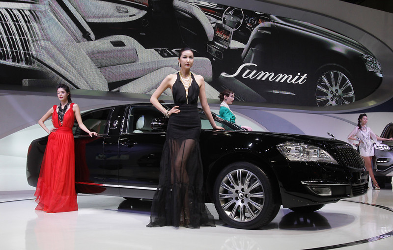 . Models pose next to a Ssangyong Chairman W Summit at the Seoul Motor Show 2013 on March 28, 2013 in Goyang, South Korea. The Seoul Motor Show 2013 will be held in March 29-April 7, featuring state-of-the-art technologies and concept cars from global automakers. The show is its ninth since the first one was held in 1995. About 384 companies from 14 countries, including auto parts manufacturers and tire makers, will set up booths to showcase trends in their respective industries, and to promote their latest products during the show.  (Photo by Chung Sung-Jun/Getty Images)